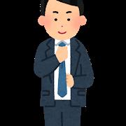 スーツ姿の男性 笑顔でネクタイを締める